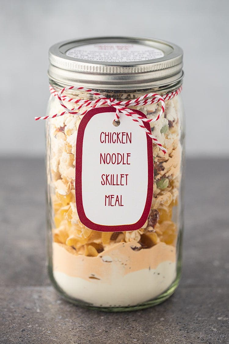 Picture of Chicken Noodle Skillet Meal in a Jar sitting on a gray countertop with label and gift tag.
