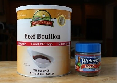 Examples of packaging for powdered beef bouillon, a large #10 can from Augason Farms, and a small glass jar of Wyler's brand bouillon.