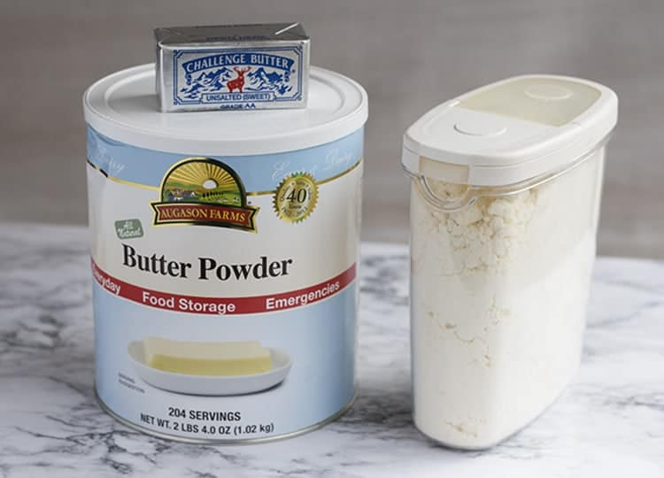 Containers of butter powder on counter.