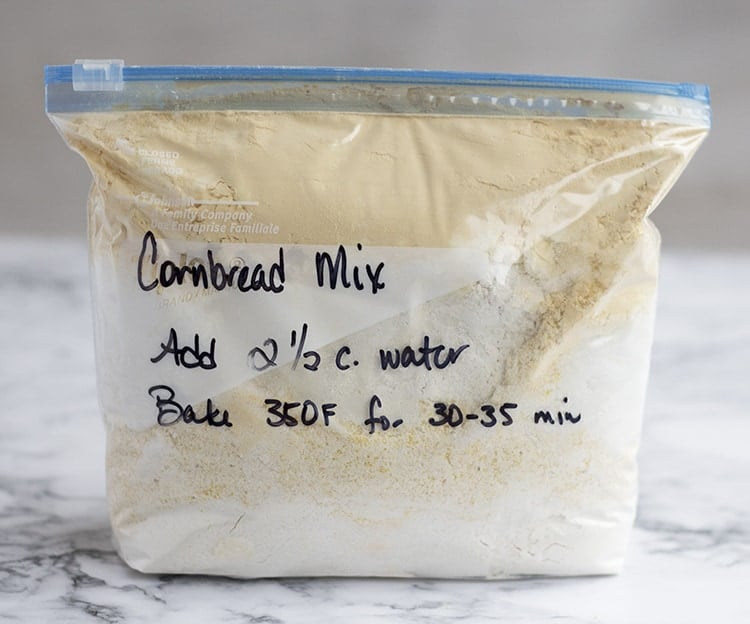 Bag of cornbread mix sitting on counter, with instructions written on front.