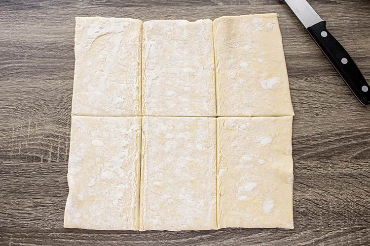 Pastry sheet laid out to show how to cut to make Easy Breakfast Pastries.
