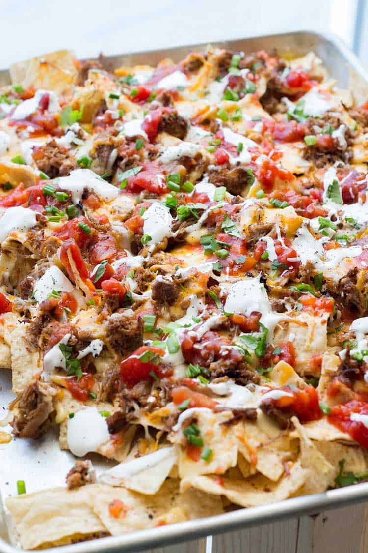 Tray of Nachos topped with Mexican Pulled Pork