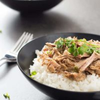 Easy Smokey Pulled Pork in bowls over rice