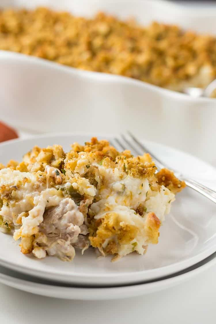 Thanksgiving Casserole on plate with cheesy layer showing