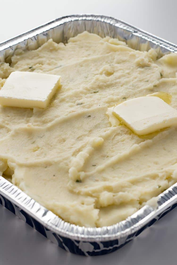 Garlic Herb Mashed Potatoes in aluminum pan for freezing