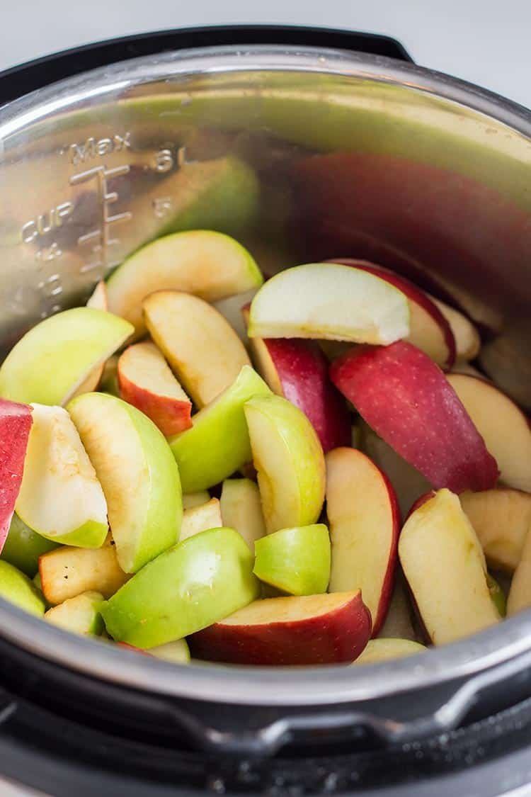 Prepared apples with peels left on, in the cooking pot of the Instant Pot pressure cooker