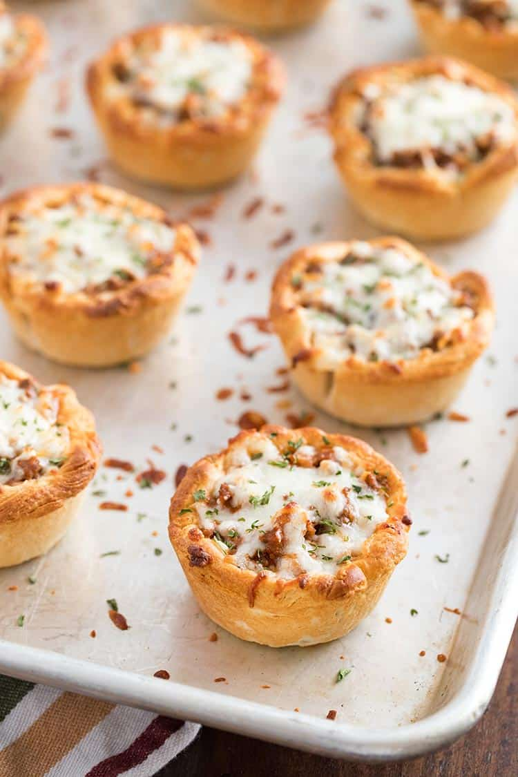 Savory Italian Biscuit Cups after final bake, on baking sheet with melted cheese on top