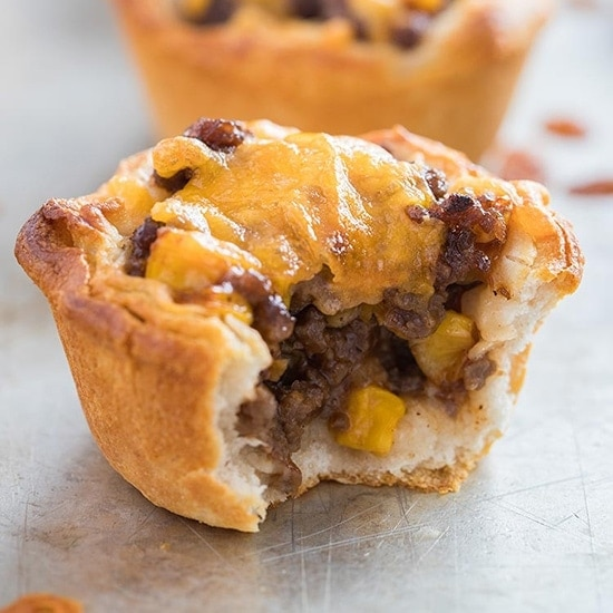 Barbecue Beef Biscuit Cup on baking tray with bite taken out of it.