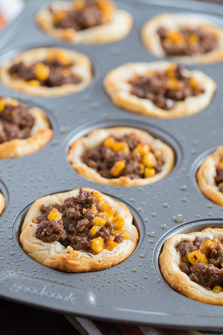 Beefy Barbecue Biscuit Cups cooked in muffin tin, ready to freeze