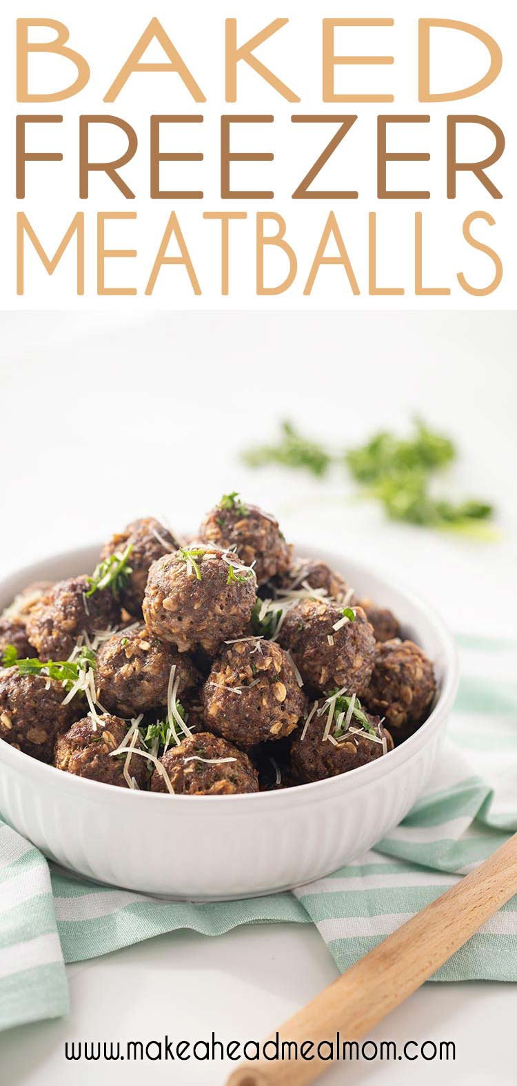 Easy Baked Freezer Meatballs stacked in white bowl and garnished with cheese and parsley