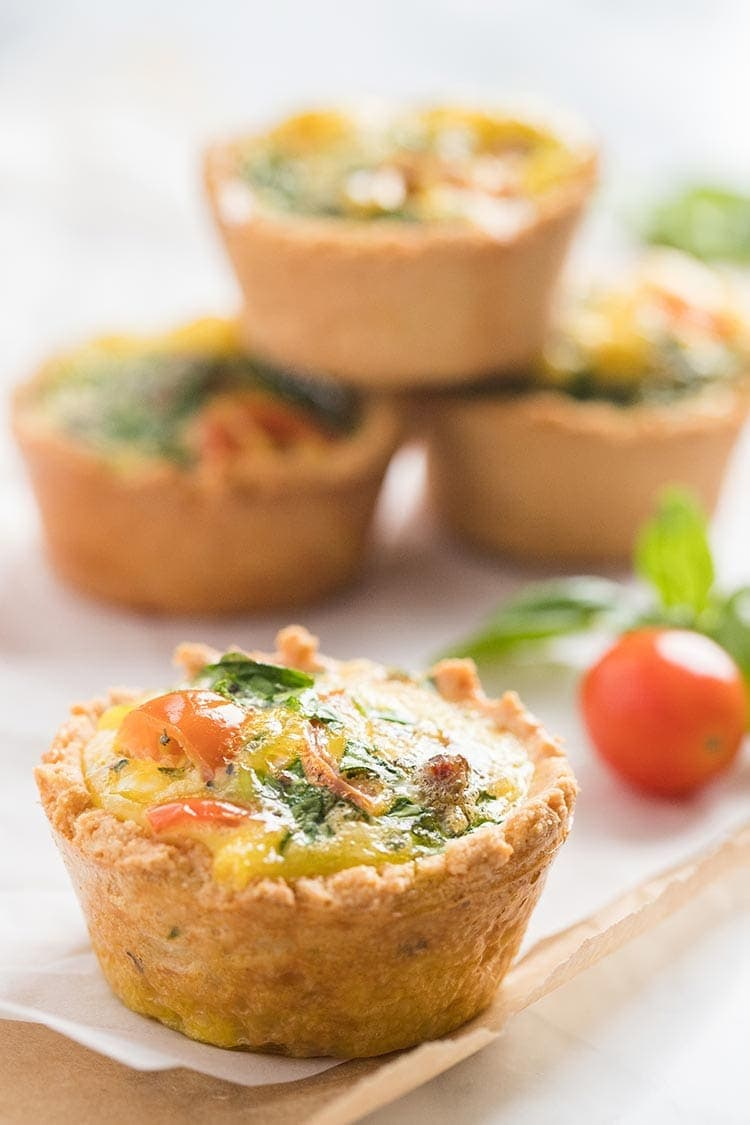 LowCarb Mini Quiches with Almond Flour Crust stacked on the counter