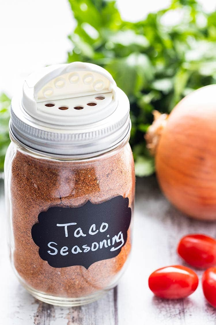 Taco seasoning mix in a pint-size mason jar with a chalkboard label on the front and a shaker lid on top