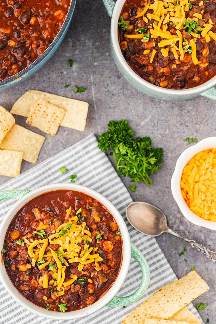 Overhead shot of table set with two bowls of Taco Soup in a Jar and garnishes.