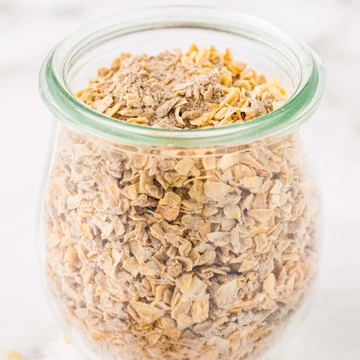 Small glass jar containing dry onion soup mix.